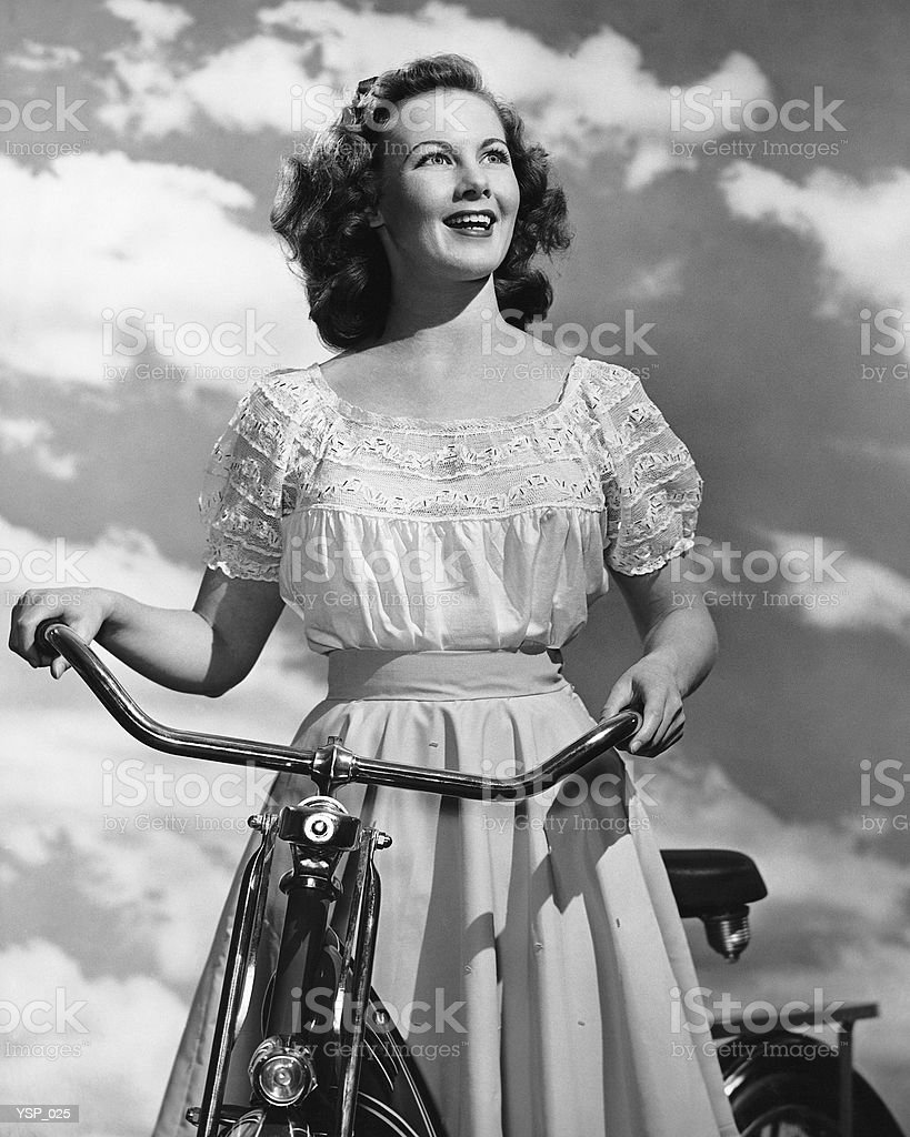 Woman standing with bicycle royalty-free stock photo