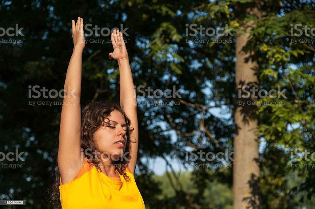 Woman standing with closed eyes stock photo