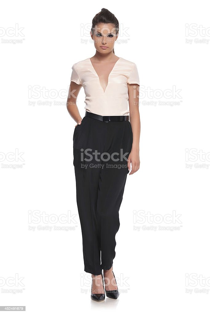 woman standing with hand in pocket stock photo