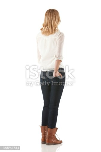 istock Woman standing with her hands in pockets 185241544