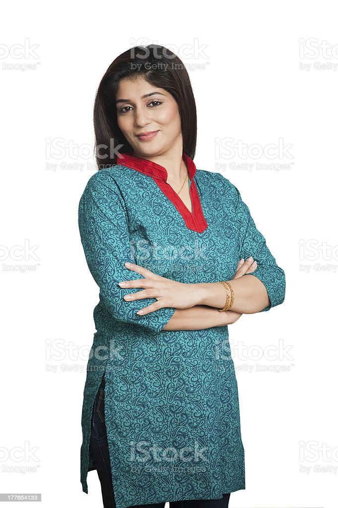 woman standing with his arms crossed stock photo