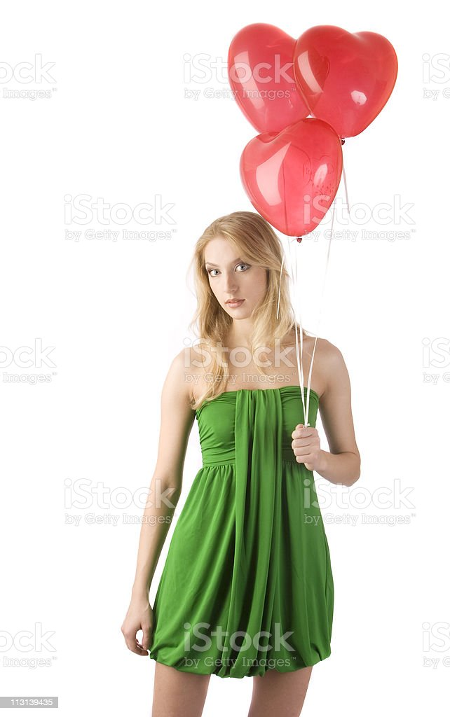 Woman standing with three balloons, front view. royalty-free stock photo
