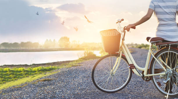 Woman standing with vintage bicycle relaxing in summer sunset nature picture id680356790?b=1&k=6&m=680356790&s=612x612&w=0&h=cz0kbvq22iaaf7mjikesrov7n7xvv6rynyma5f1gzek=