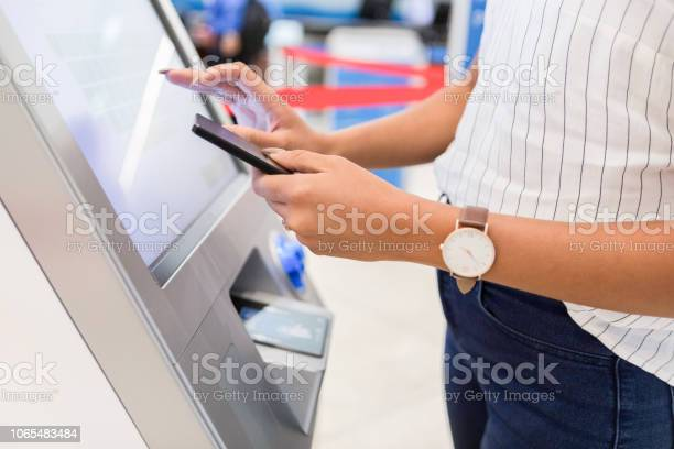 Woman stands at a kiosk in an airport as she gets her luggage tags picture id1065483484?b=1&k=6&m=1065483484&s=612x612&h=kbpoyyr73x3r58wjkxzkaz0qf ybauykxchxne6xejg=