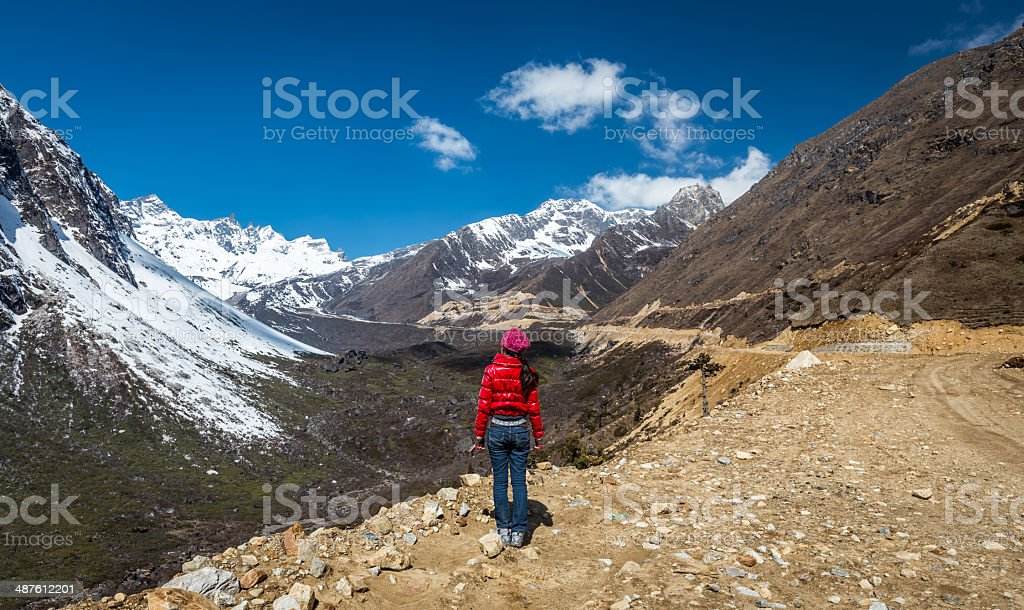 woman stands near Chopta Valley ,Sikkim,India stock photo