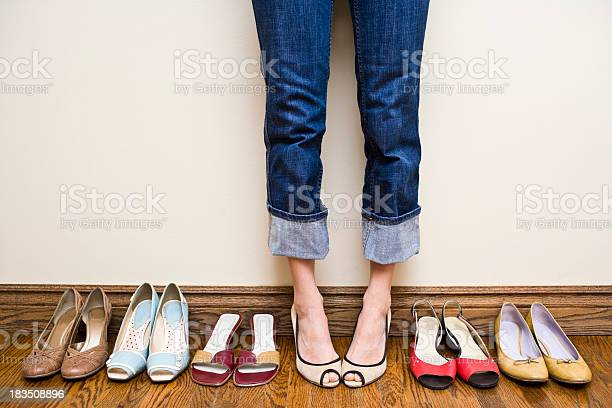 Woman stands wearing heels with her collection of shoes picture id183508896?b=1&k=6&m=183508896&s=612x612&h=jb0x9tiuoknwaoczvnprycaszkk 288hpe4vaav7ybq=