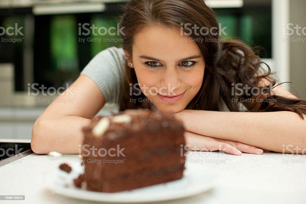 Woman staring at chocolate cake stock photo