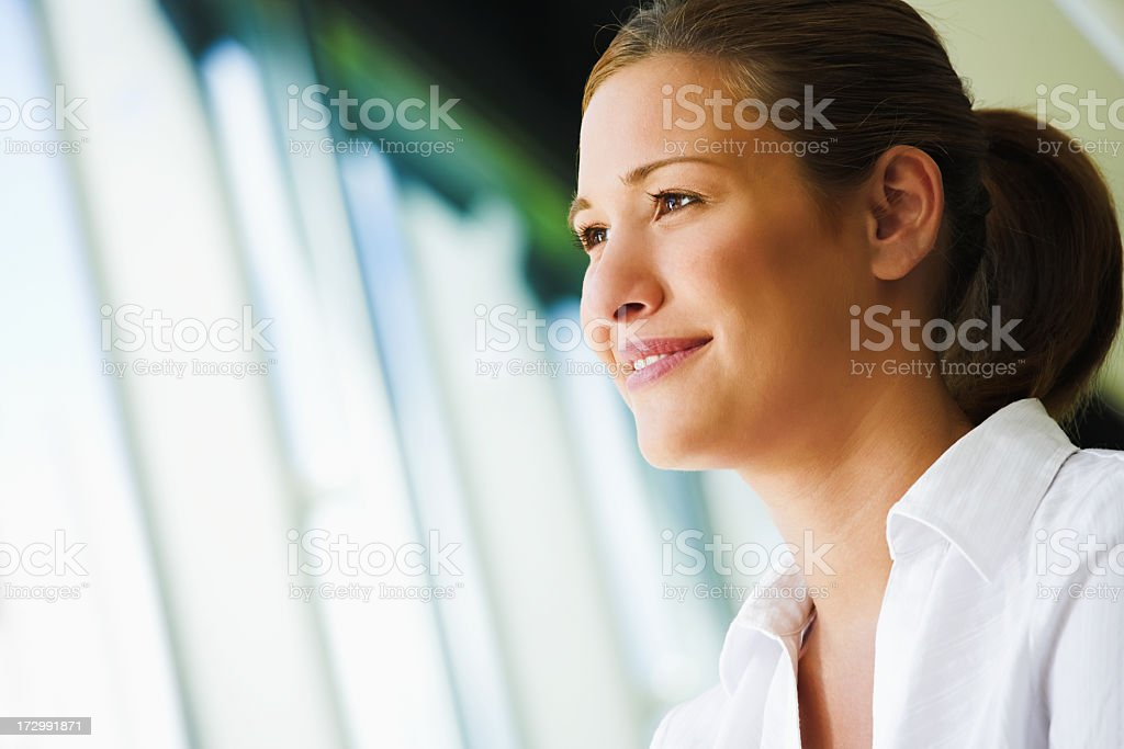 Woman staring outside open window blinds stock photo