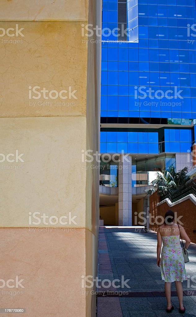 woman staring up at large corprate building royalty-free stock photo