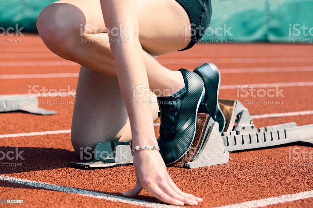 Woman start position stock photo
