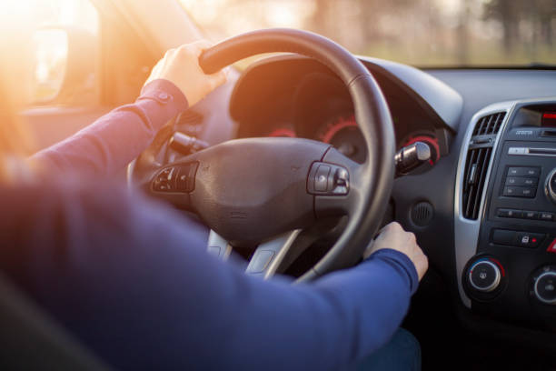 woman starting car - beginnings stock photos and pictures