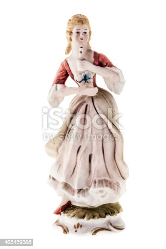 German statuette depicting a traditional dressed woman Isolated on white