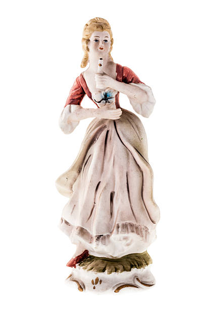 woman statuette - figurine stock photos and pictures
