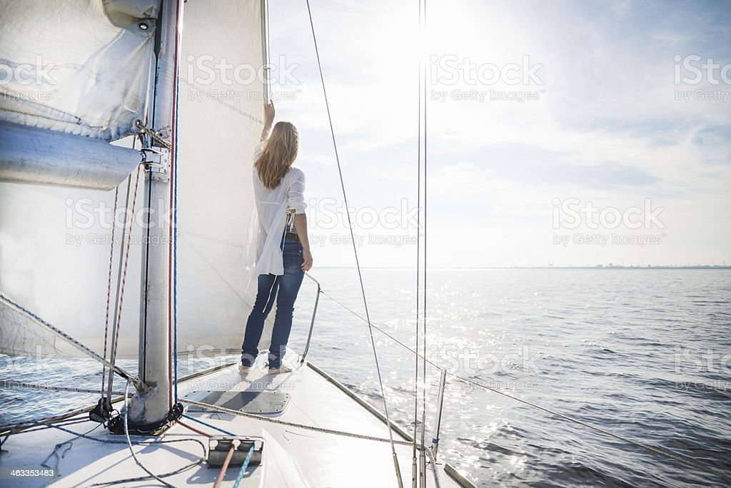woman staying on sailboat stock photo