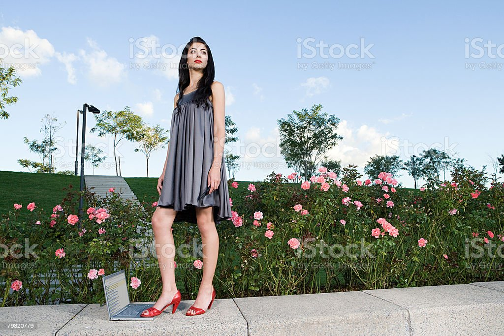 Woman stepping on a laptop computer 免版稅 stock photo