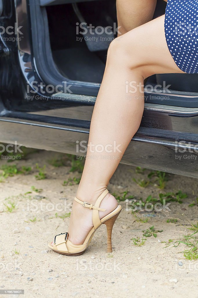 Woman stepping out of the car royalty-free stock photo