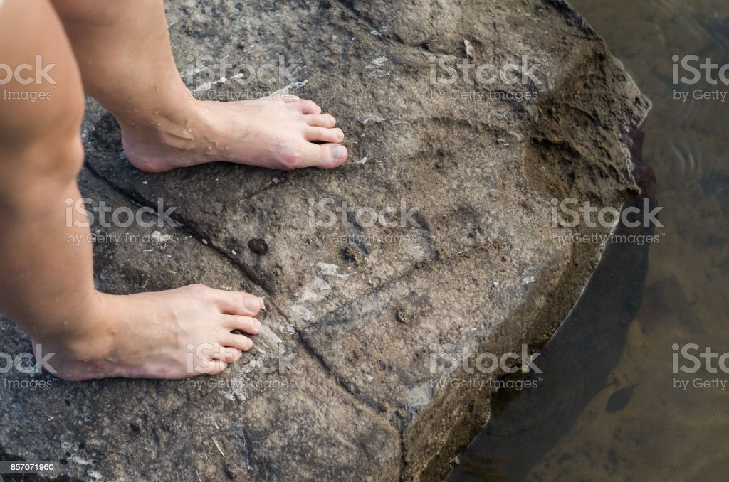 Woman stone legs stock photo