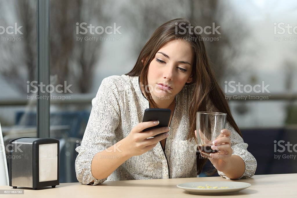 Woman stood up in a coffee shop stock photo