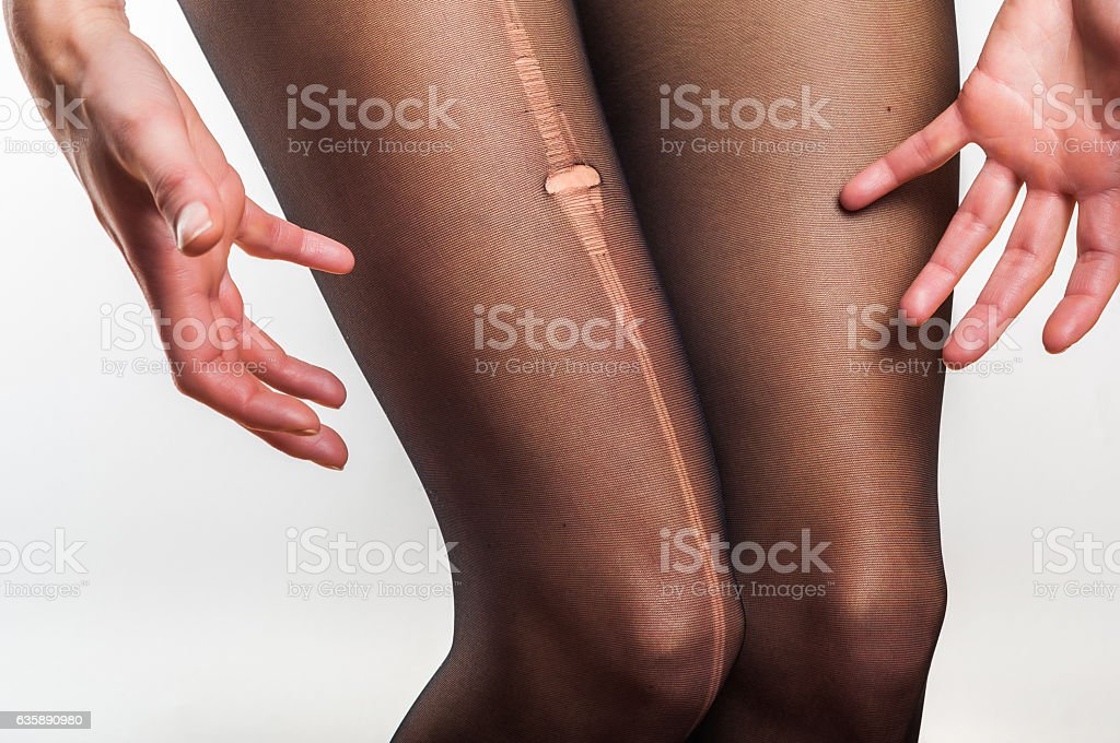 woman stressed about torn tights stock photo