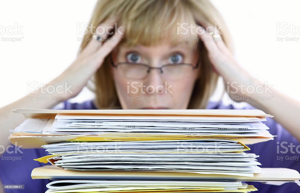 Woman Stressed by Paperwork Overload royalty-free stock photo