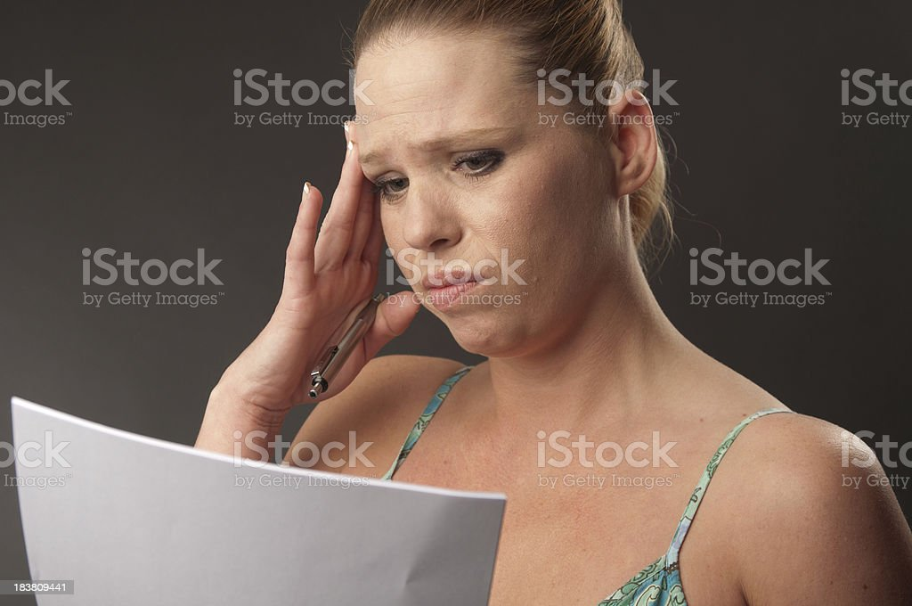 Woman Stressed Out Over Paperwork royalty-free stock photo