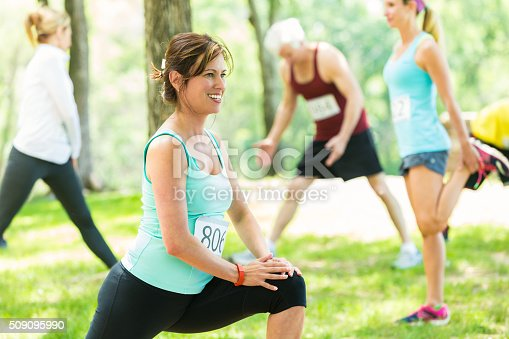 istock Woman stretches before 5k race 509095990