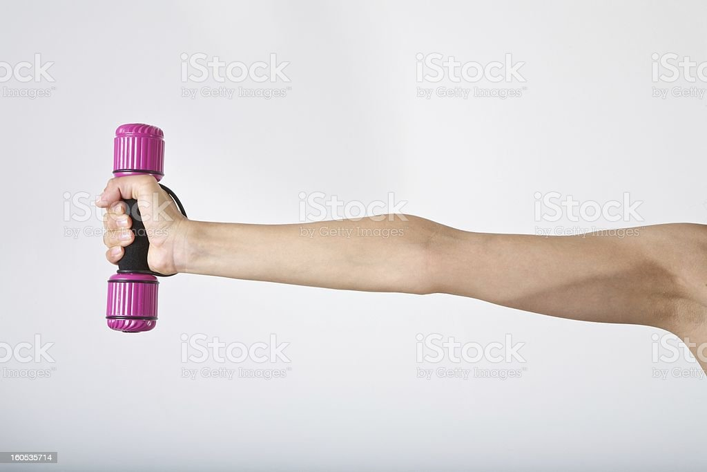 woman stretching a dumbbell royalty-free stock photo
