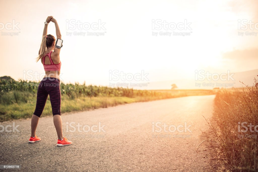 Woman stretching and breathing stock photo