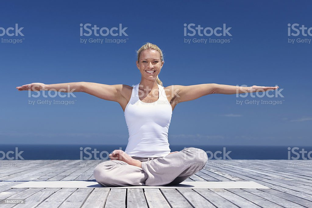 Woman stretching arms royalty-free stock photo