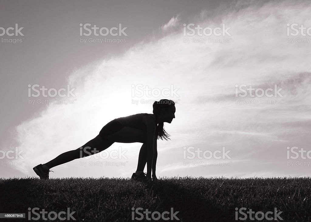Woman stretching before her morning run royalty-free stock photo