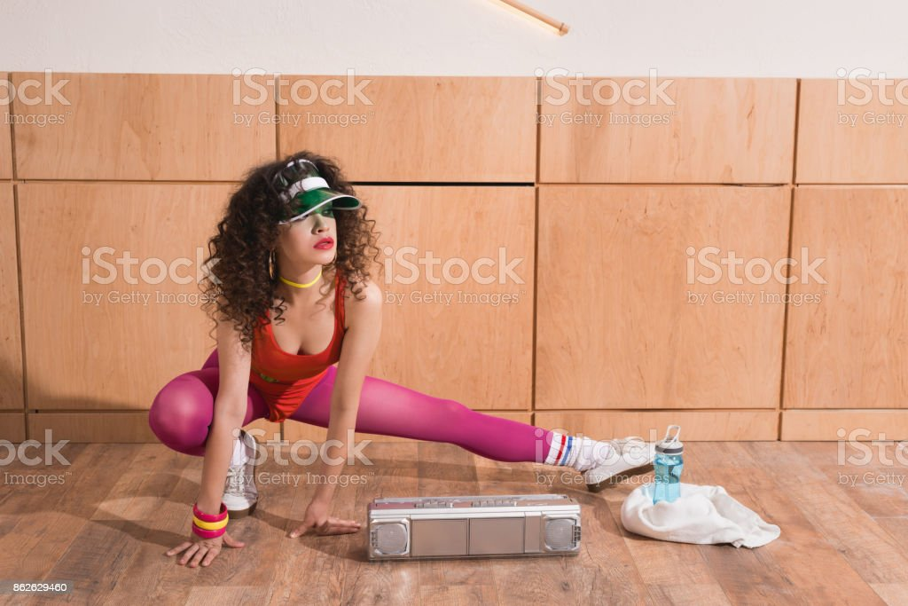 woman stretching before training stock photo