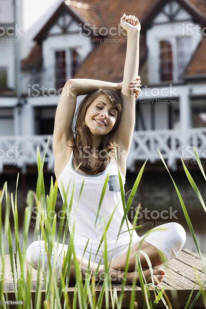 Woman stretching exercising stock photo