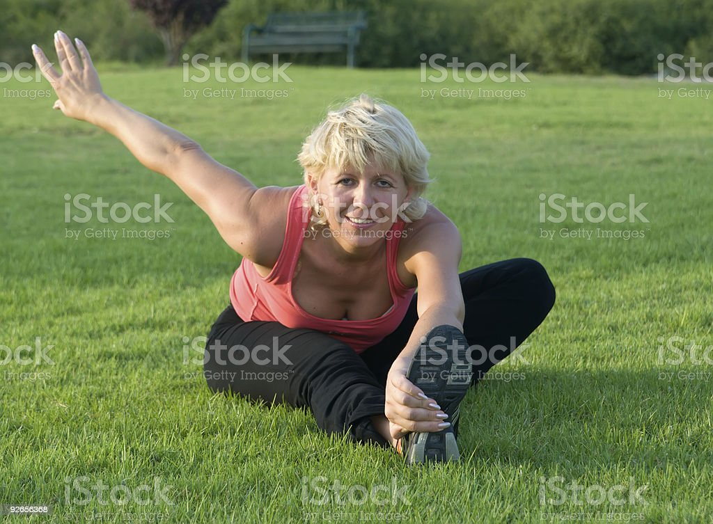 Woman stretching her leg royalty-free stock photo
