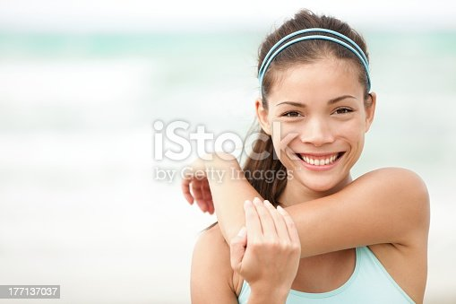 istock Woman stretching her shoulder and smiling 177137037