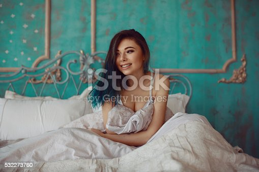 532275426 istock photo Woman stretching in bed after wake up 532273760