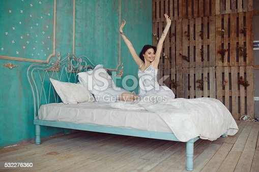 532275426 istock photo Woman stretching in bed after wake up 532276360
