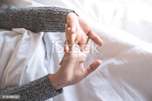 istock woman stretching in bed after wake up. 916469032