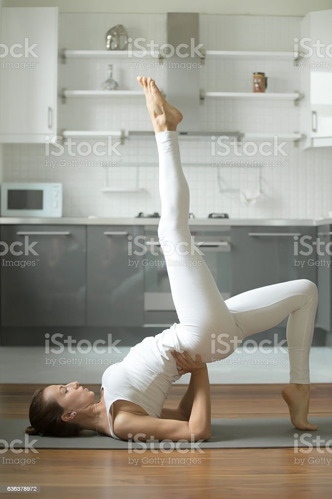 Woman stretching in Bridge exercise stock photo