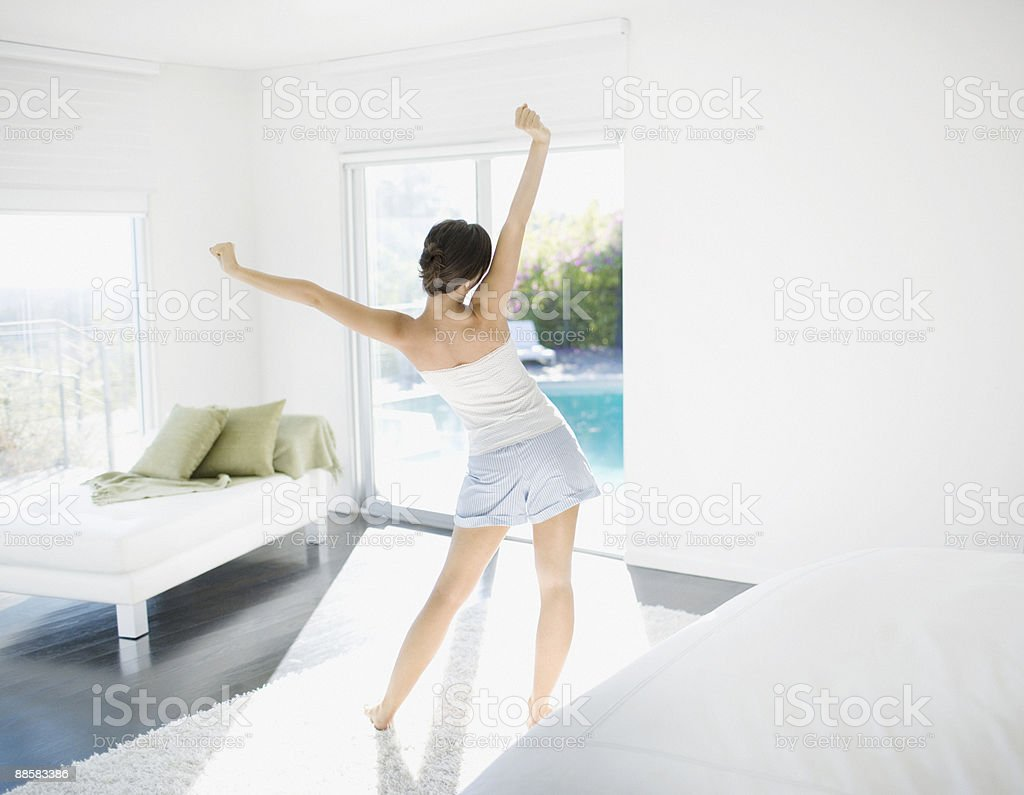 Woman stretching in living room royalty-free stock photo