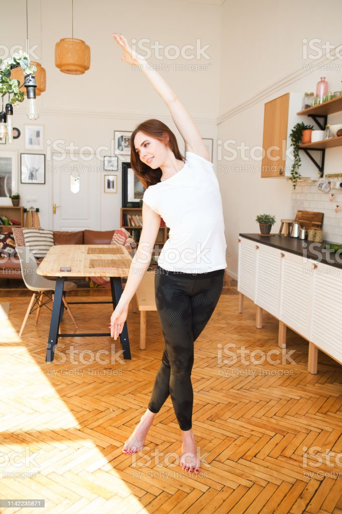 Woman stretching in room at home. Healthy and sport lifestyle....