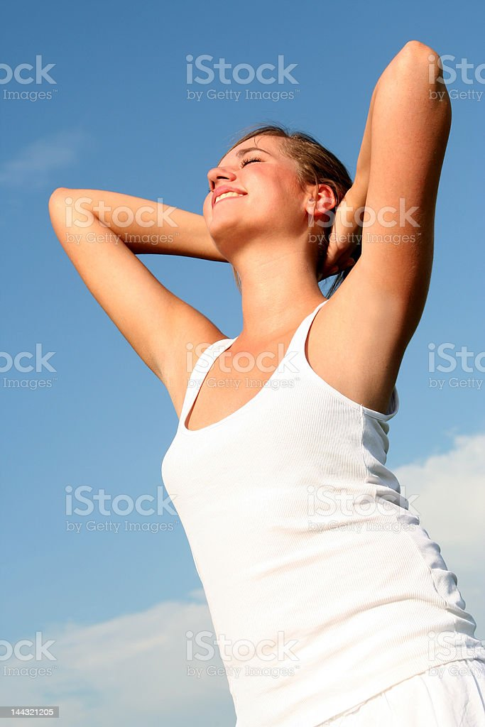 Woman stretching in sunlight royalty-free stock photo