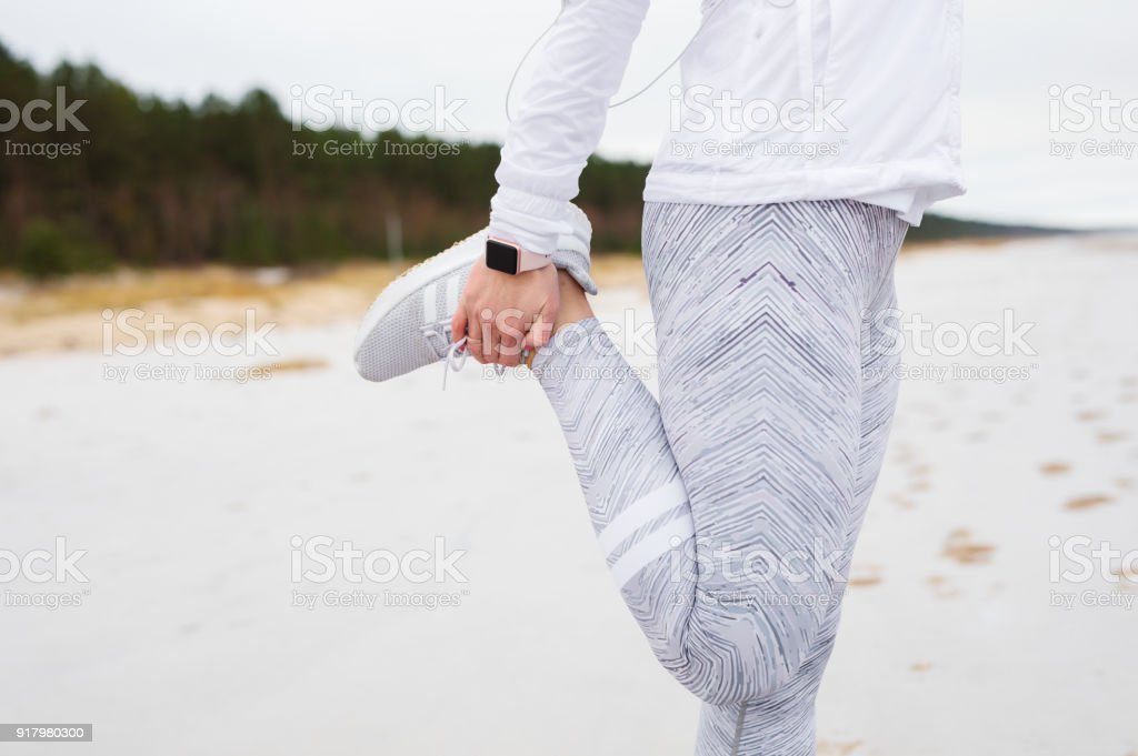 Woman stretching leg before run stock photo