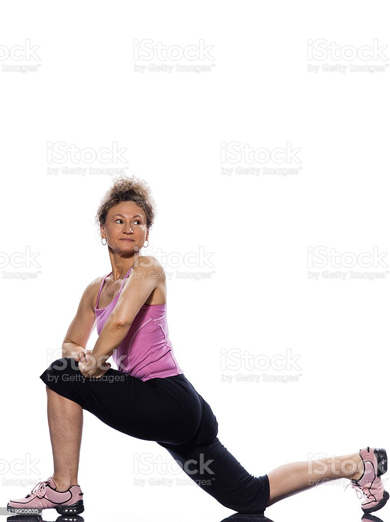 woman stretching legs posture kneeling royalty-free stock photo