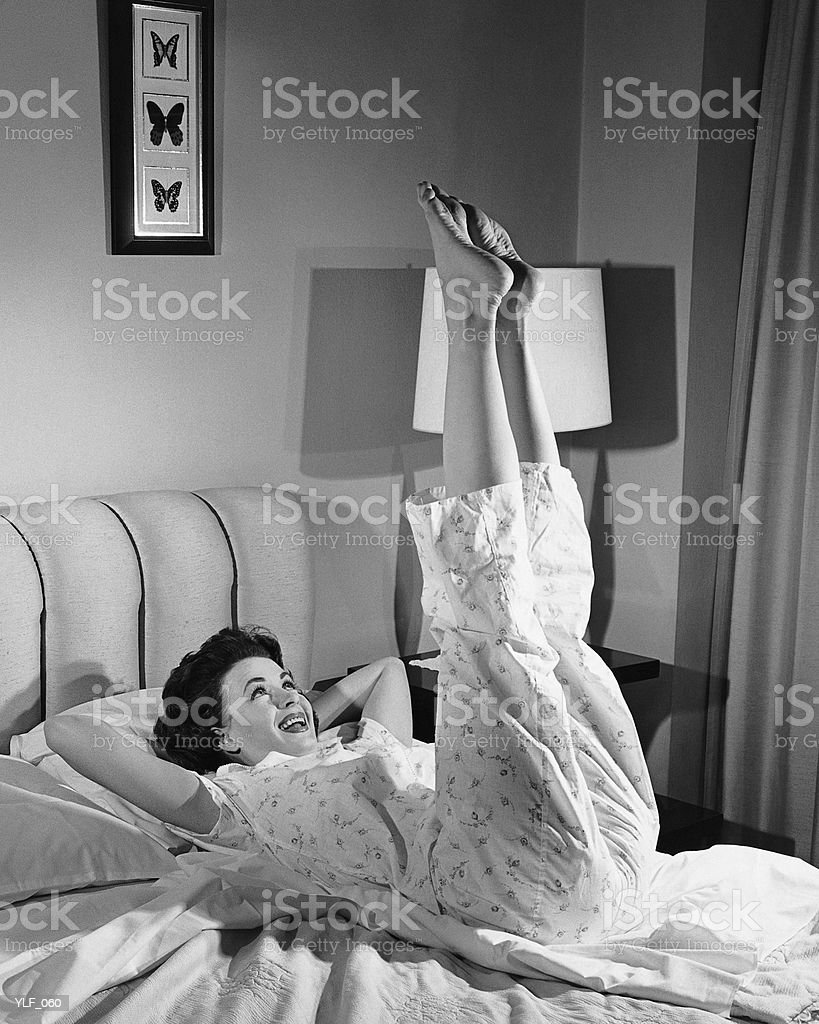 Woman stretching on bed royalty-free stock photo