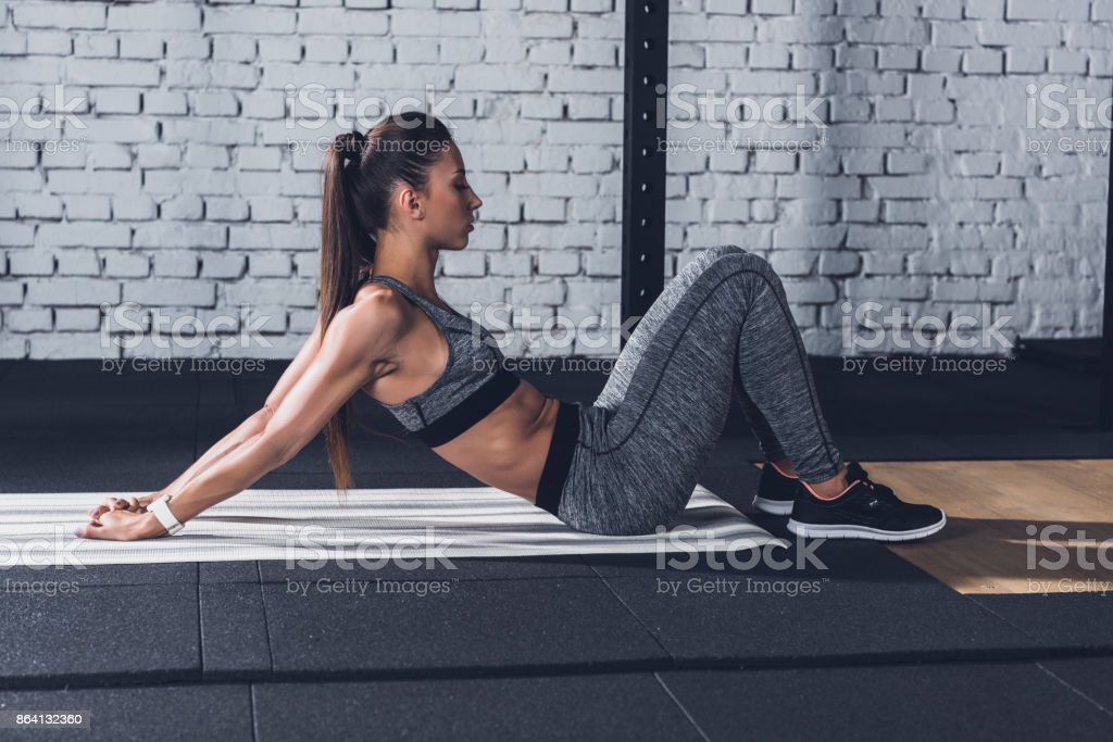 woman stretching on mat royalty-free stock photo
