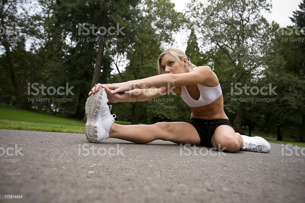 Woman Stretching on Road royalty-free stock photo
