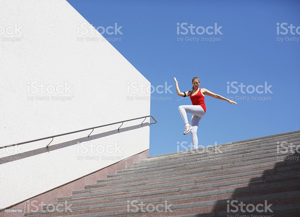 Woman stretching on staircase before exercise royalty-free stock photo