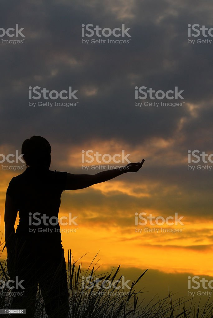 woman stretching out her arm royalty-free stock photo