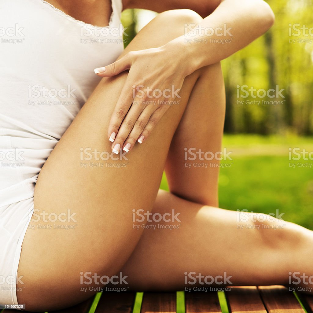 woman stretching outdoors in nature stock photo