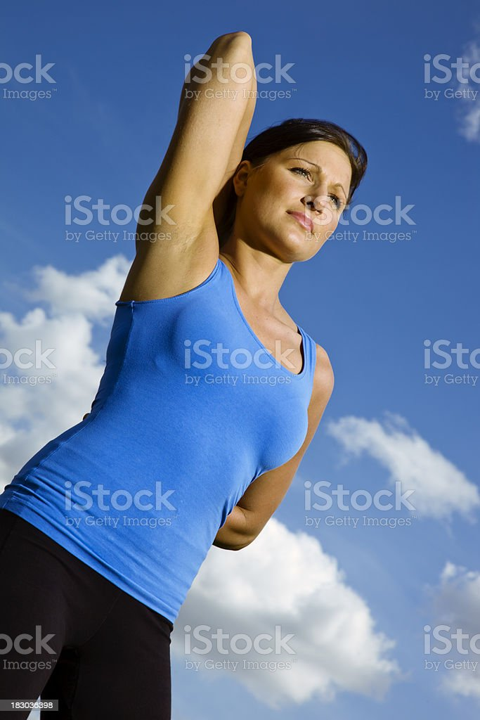 Woman Stretching Outdoors royalty-free stock photo